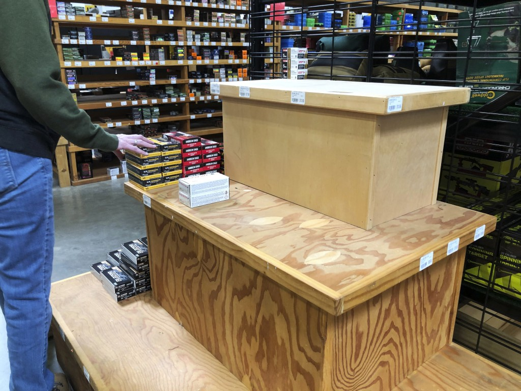 This image taken March 14, 2020, shows a nearly empty display shelf for ammunition at the Sportsmen's Warehouse in Meridian, Idaho. A sign at the stor...