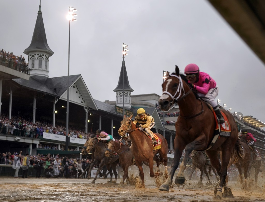 FILE - In this May 4, 2019, file photo, Luis Saez rides Maximum Security, right, across the finish line first against Flavien Prat on Country House du...