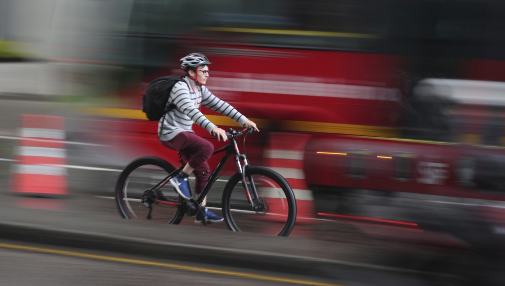 A man rides his bicycle in Bogota, Colombia, Monday, March 16, 2020. Officials in Colombia's capital have expanded bike routes, encouraging people to ...