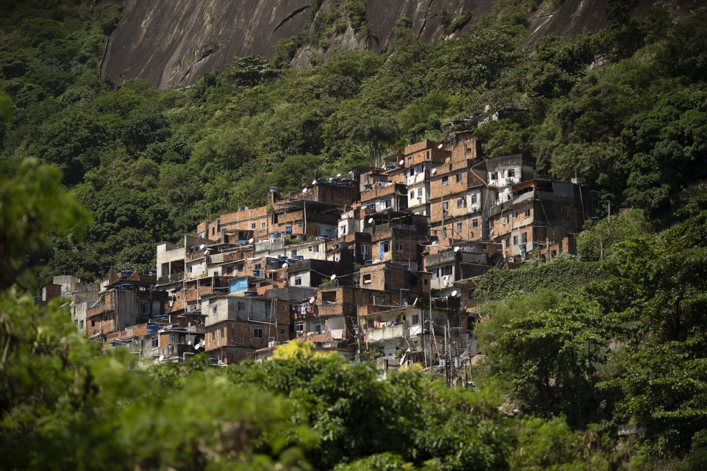 The Rocinha favela stands out from a hillside in Rio de Janeiro, Brazil, Monday, March 16, 2020. Rocinha, Brazil's largest favela, is home to about 70...