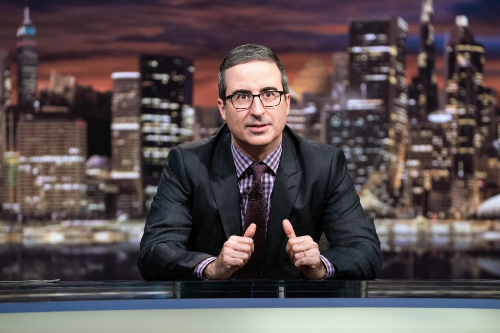"This March 3, 2019 photo released by HBO shows John Oliver, host of ""Last Week Tonight with John Oliver."" Six people at CBS News have  tested positive..."