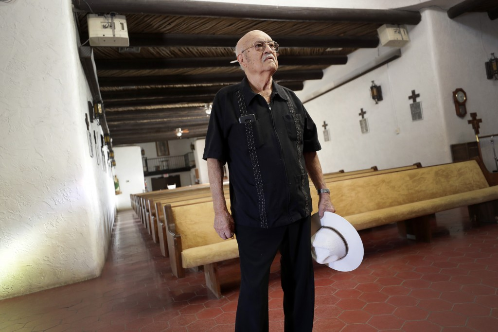 Frank Cota stands inside Our Lady of Guadalupe church Friday, Jan. 24, 2020 in Guadalupe, Ariz. Founded by Yaqui Indian refugees from Mexico more than...