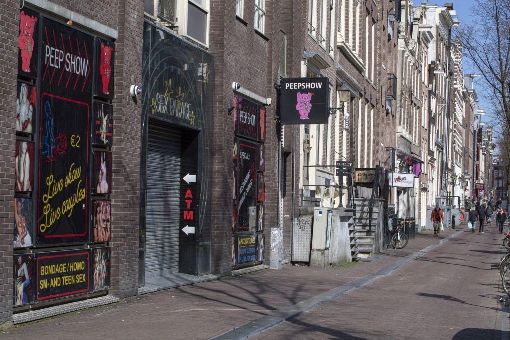 The narrow canal-side streets and alleys of Amsterdam's famed Red Light District, normally packed with tourists, were largely deserted Monday March 16...