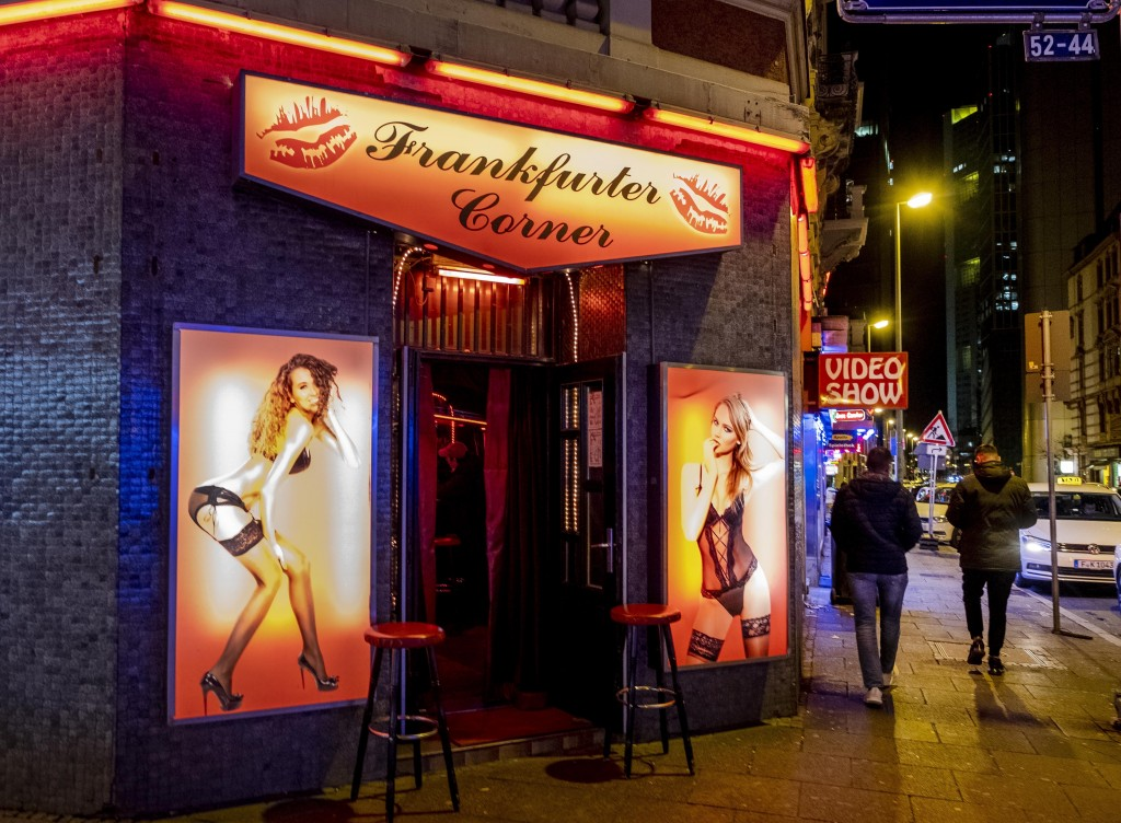 People walk through the red light district in Frankfurt, Germany, Saturday, March 14, 2020. Only for most people, the new coronavirus causes only mild...