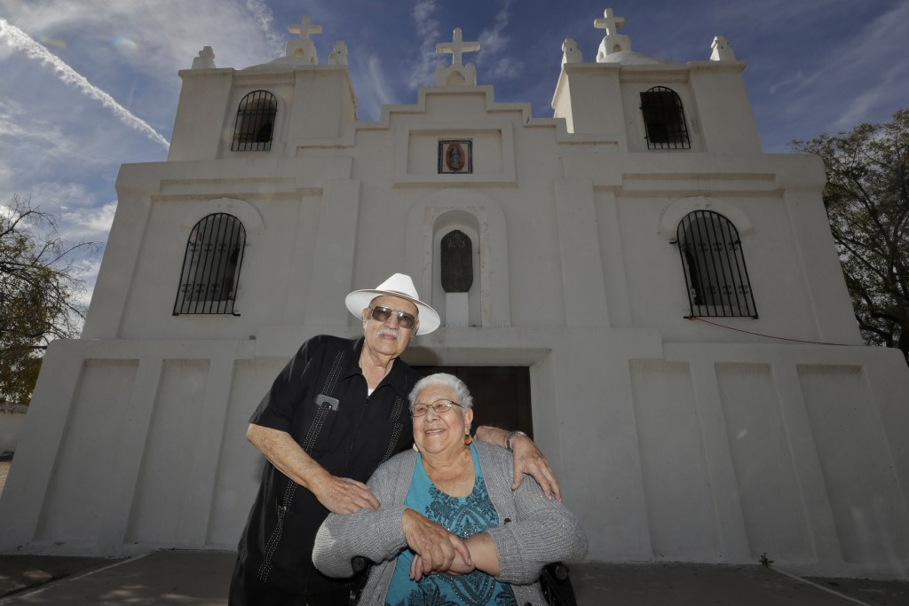 Frank and Ester Cota pose for a photograph outside Our Lady of Guadalupe church Friday, Jan. 24, 2020 in Guadalupe, Ariz. Founded by Yaqui Indian refu...