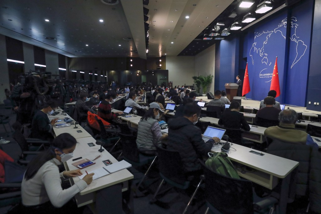 Chinese Foreign Ministry spokesman Geng Shuang speaks during a daily briefing in Beijing, March 18, 2020.