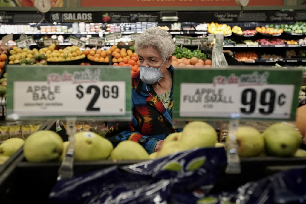 Carmen Zamora shops at Northgate González Market on Tuesday, March 17, 2020, in Santa Ana, Calif. In light of the coronavirus concerns the Northgate m...