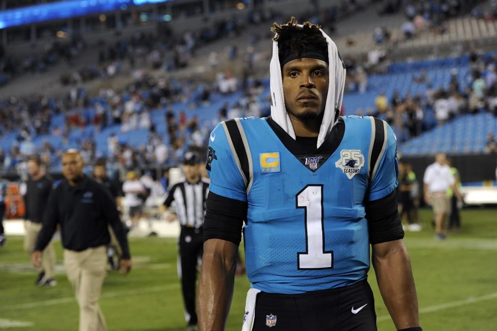 FILE - In this Sept. 13, 2019, file photo, Carolina Panthers quarterback Cam Newton (1) walks off the field following the Panthers 20-14 loss to the T...