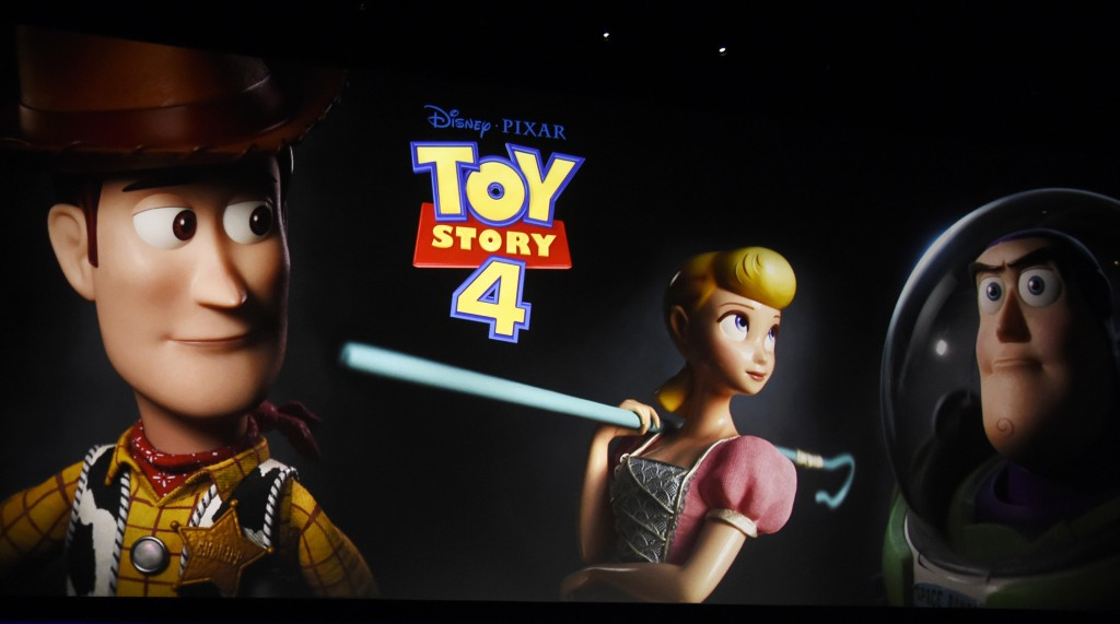"""FILE - This April 3, 2019, file photo shows a preview image of the upcoming film """"Toy Story 4"""" on state during the Walt Disney Studios Motion Pictures..."""