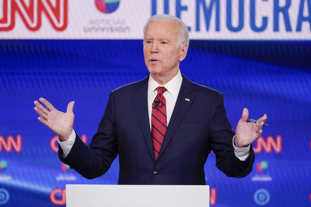 FILE- In this Sunday, March 15, 2020 file photo, former Vice President Joe Biden, participates in a Democratic presidential primary debate at CNN Stud...