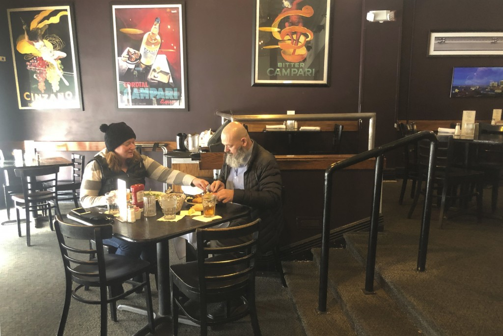 Danny Flanigan and Jennie Mulhall have lunch at their favorite restaurant, the Bristol, in Louisville, Ky., on Monday, March 16, 2020, before the stat...