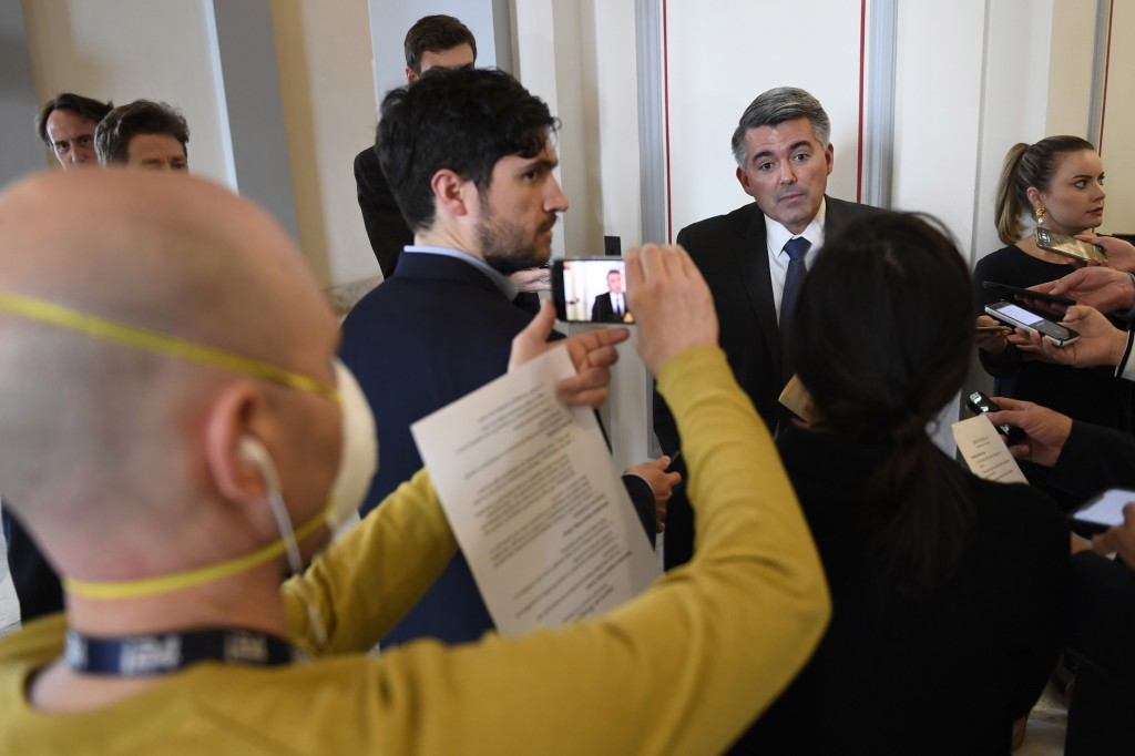 Sen. Cory Gardner, R-Colo., talks with reporters as he heads to the weekly Republican policy lunch on Capitol Hill in Washington, Tuesday, March 17, 2...
