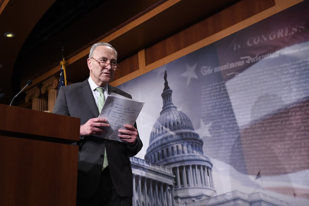 Senate Minority Leader Sen. Chuck Schumer of N.Y., walks off of the stage after speaking at a news conference on Capitol Hill in Washington, Tuesday, ...