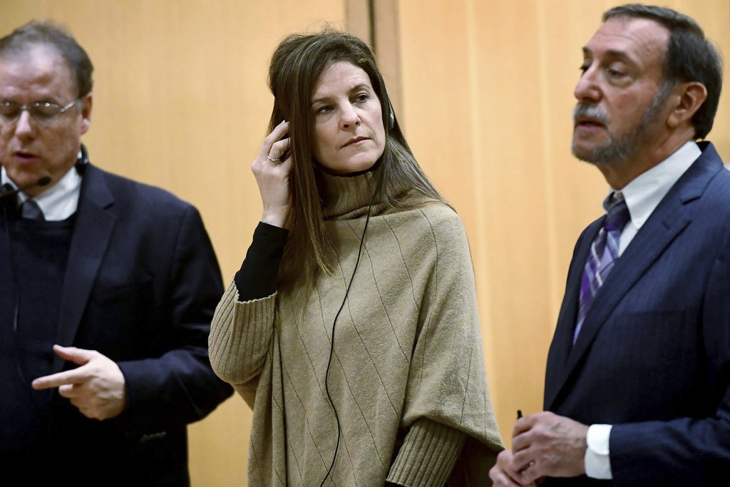 FILE - This Feb. 6, 2020 file photo shows Michelle Troconis appearance for a pre-trial hearing with an interpreter and her attorney Jon L. Schoenhorn,...