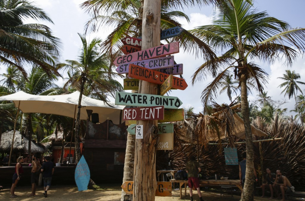 Destination signs cover a post at the end of the annual Tribal Gathering on Playa Chiquita, Panama, Wednesday, March 18, 2020. Foreigners attending th...