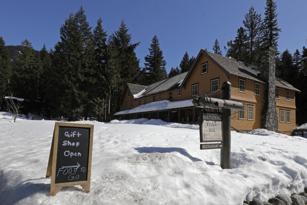 A sign at the National Park Inn at Longmire offers food orders to-go from the inn's restaurant at Mount Rainier National Park, Wednesday, March 18, 20...