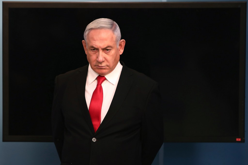 FILE - In this Saturday, March 14, 2020 file photo, Israeli Prime Minister Benjamin Netanyahu arrives for a speech from his Jerusalem office, saying I...