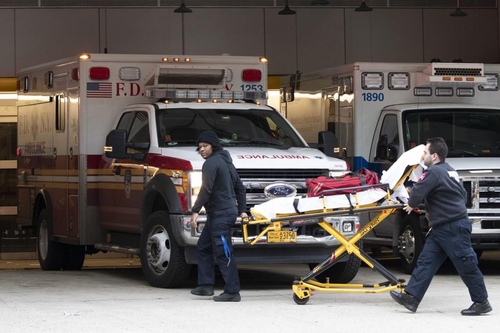 Emergency Medical Technicians wheel a collapsible wheeled stretcher into the emergency room at NewYork-Presbyterian Lower Manhattan Hospital, Wednesda...