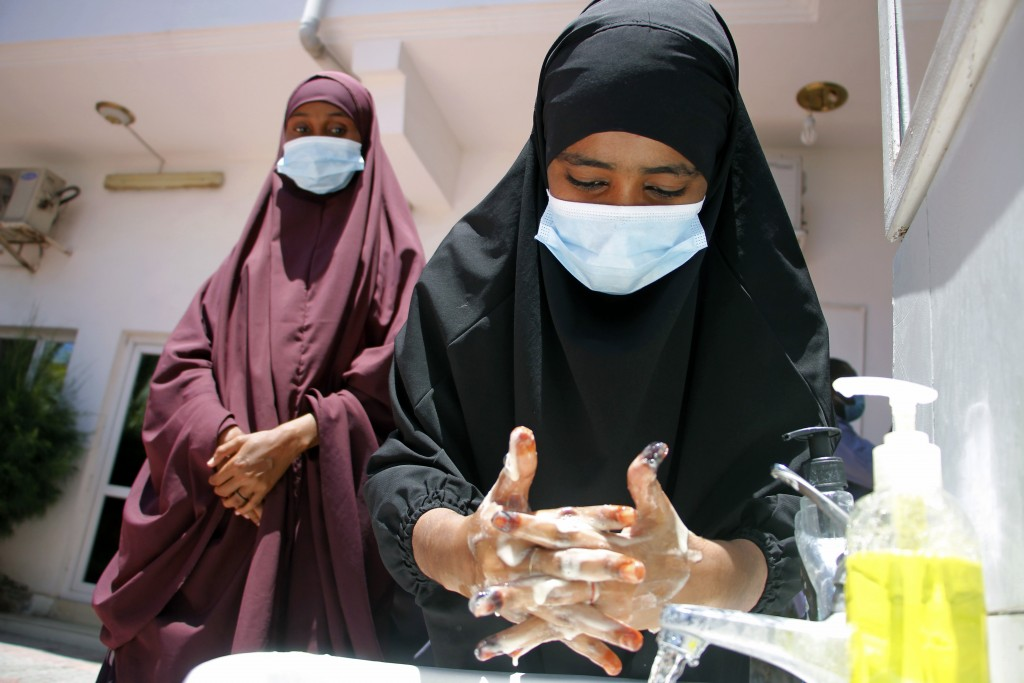 Somali female wash their hands during coronavirus awareness training conducted by the local paramedics and doctors in Somali capital Mogadishu, Thursd...