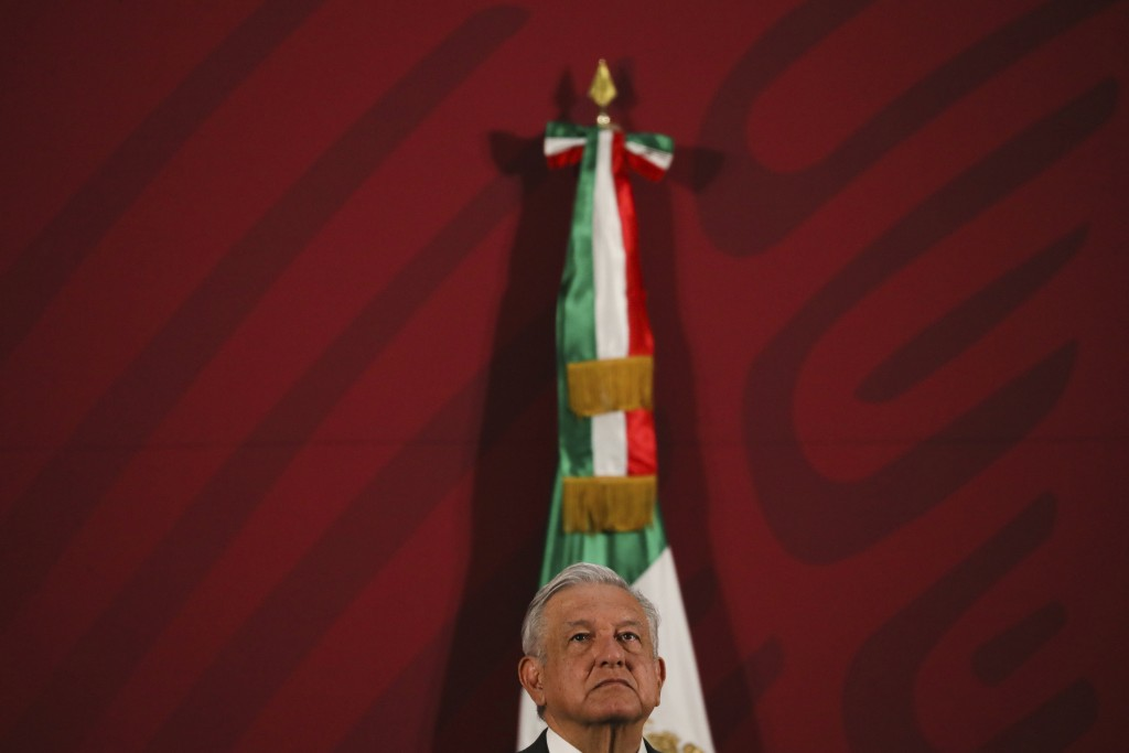 Mexico's President Andres Manuel Lopez Obrador gives his daily news conference at the presidential palace in Mexico City, early Thursday, March 19, 20...