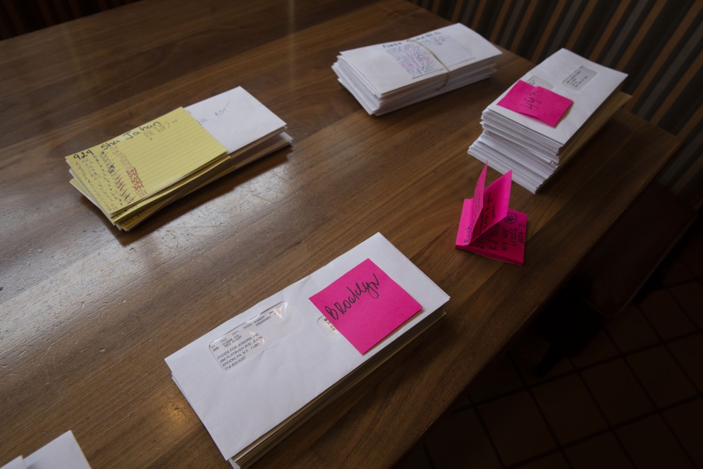 Paychecks are stacked on a table at Junior's Restaurant for distribution to employees, Thursday, March 19, 2020 in the Brooklyn borough of New York. T...