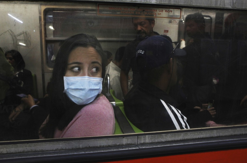A commuter in the metro wears a protective mask as a precaution against the spread of the new coronavirus in Mexico City, Thursday, March 19, 2020. (A...