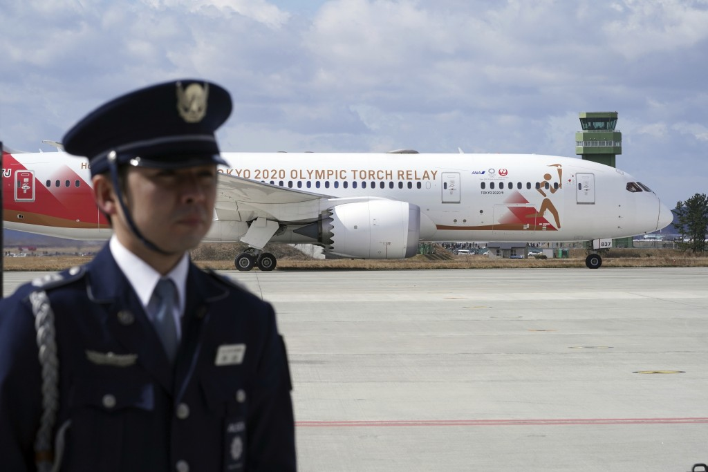 A plane carrying the Olympic flame arrives before Olympic Flame Arrival Ceremony at Japan Air Self-Defense Force Matsushima Base in Higashimatsushima ...