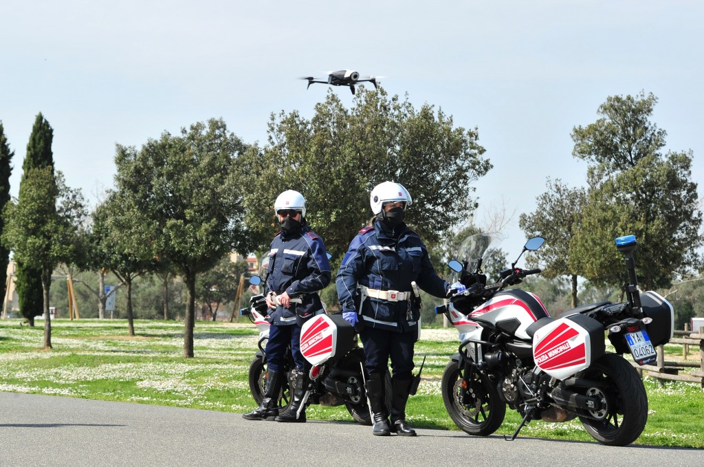 City police officers with the help of a drone monitor citizens' movements in Grosseto, central Italy, Friday, March 20, 2020 as mayors of many towns i...