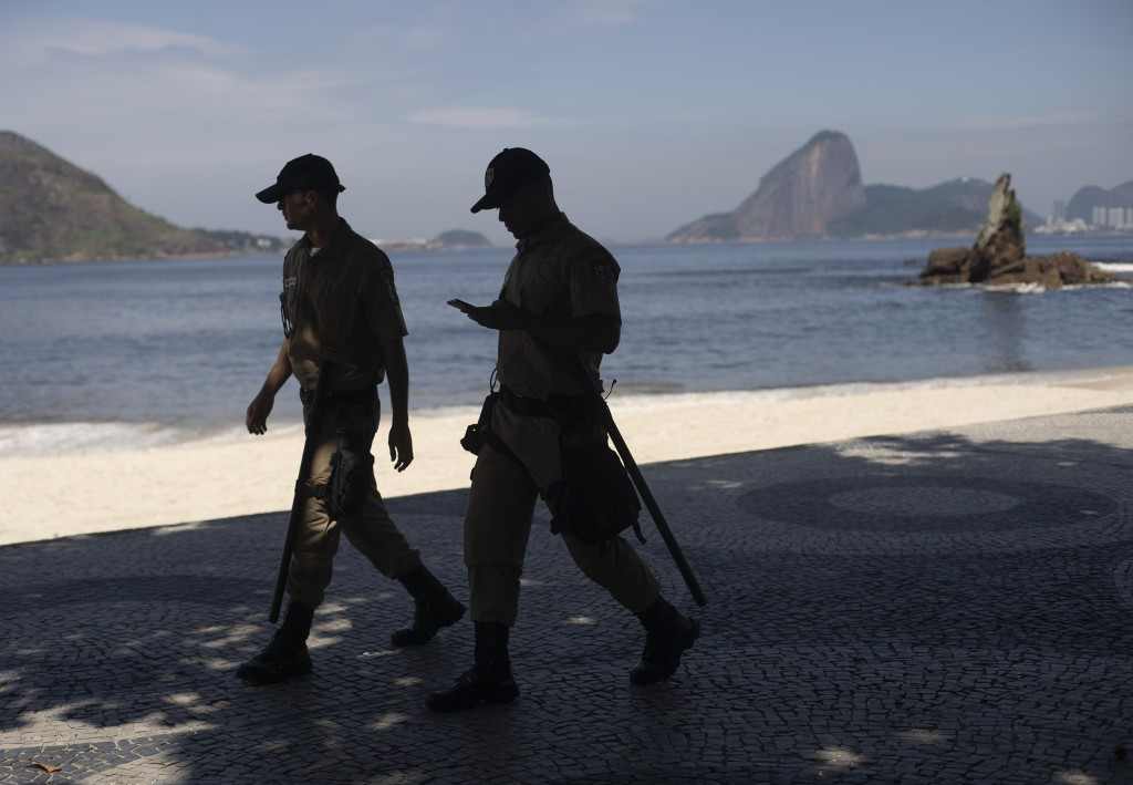 Municipal police patrol Icarai beach backdropped by Sugar Loaf mountain, both closed to visitors as a precaution against the spread of the new coronav...