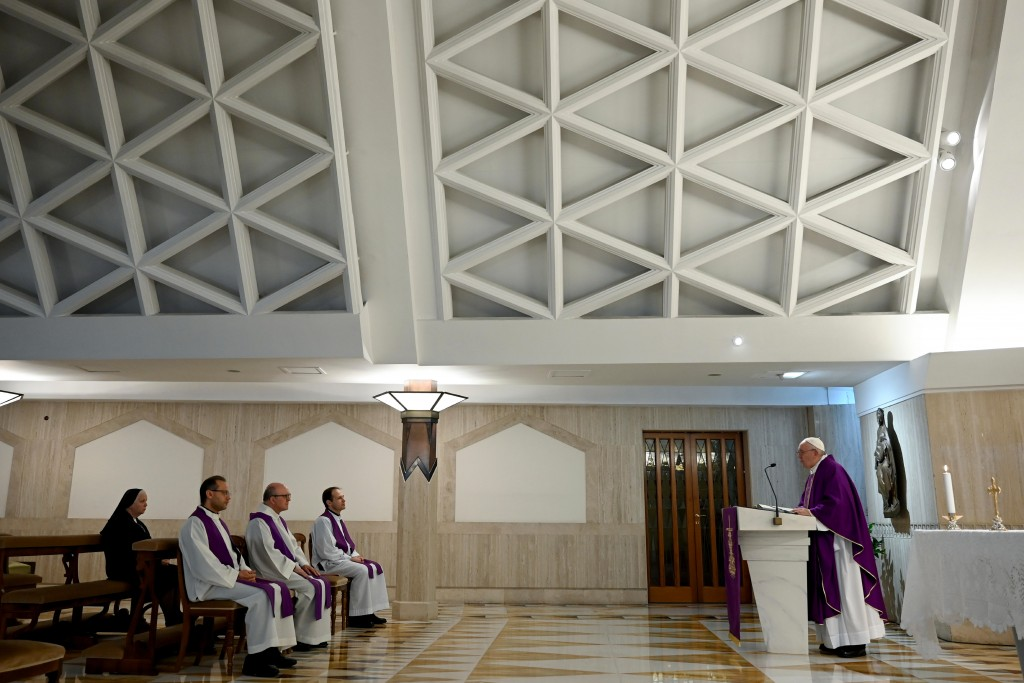 Pope Francis celebrates Mass at his Santa Marta residence at the Vatican, Friday, March 20, 2020.  The Vatican says the Catholic church is granting a ...