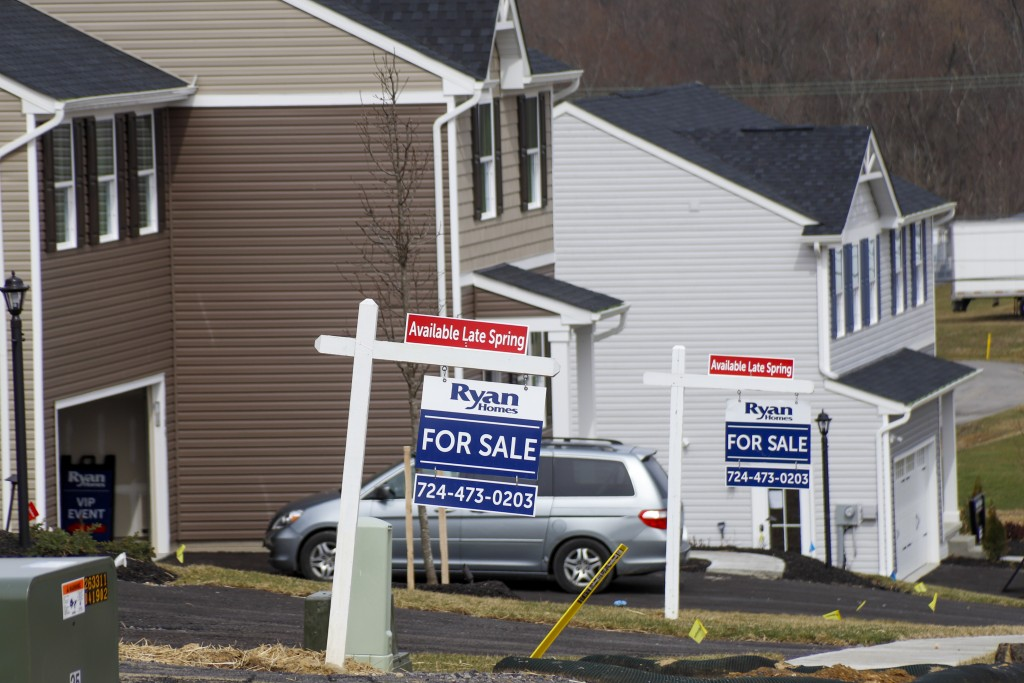 Model homes and for sale signs line the streets as construction continues at a housing plan in Zelienople, Pa., Wednesday, March 18, 2020. U.S. home s...