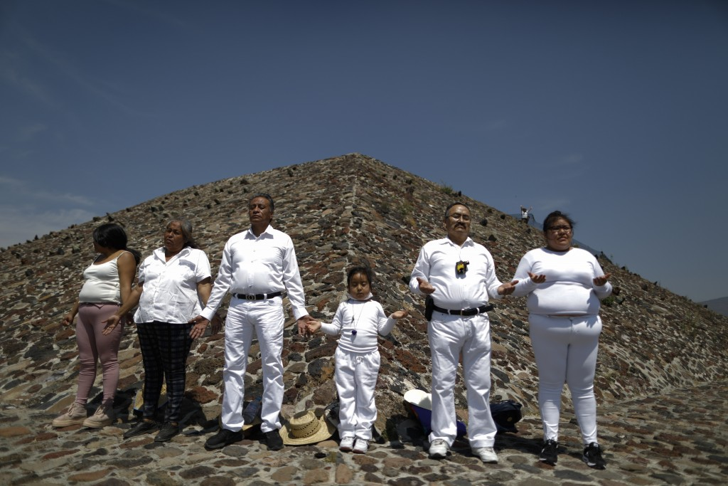 The Martinez family from Puebla celebrates the Spring equinox a little early, to avoid crowds and closures, atop the Pyramid of the Sun, in Teotihuaca...