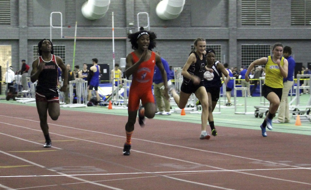 FILE - In this Feb. 7, 2019 file photo, Bloomfield High School transgender athlete Terry Miller, second from left, wins the final of the 55-meter dash...