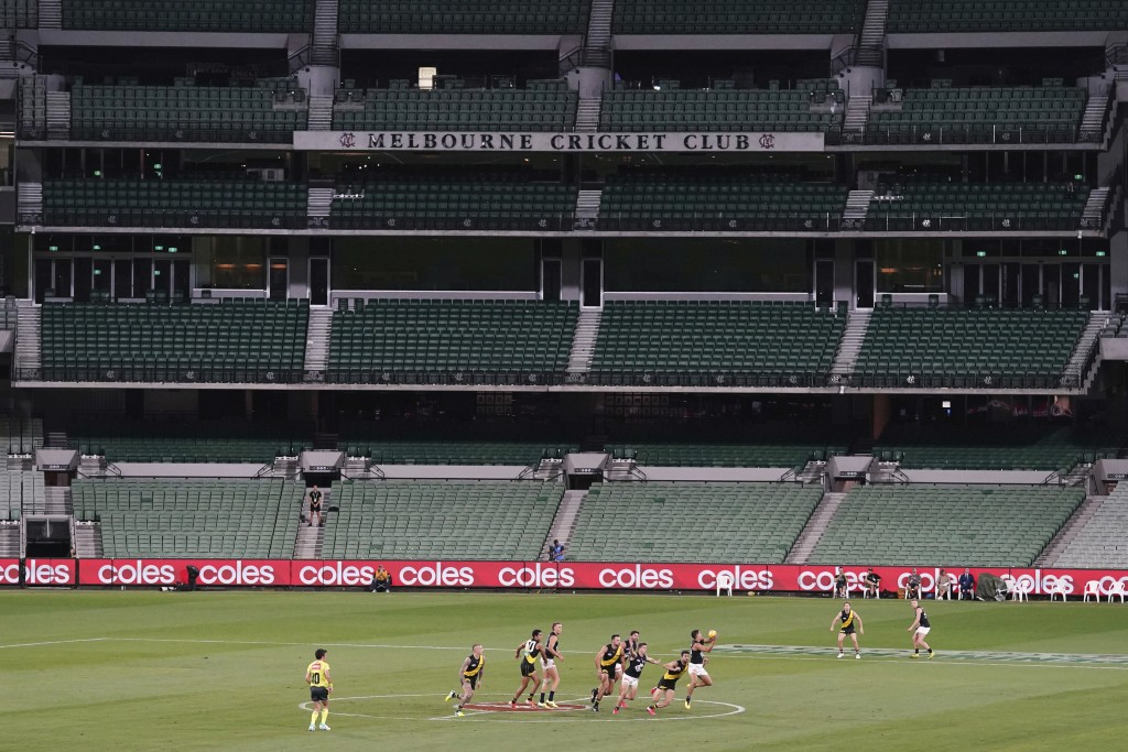Players from Richmond and Carlton play their Australian Rules Football league game at a empty Melbourne Cricket Ground in Melbourne, Thursday, March 1...