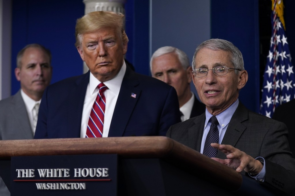 President Donald Trump listens as Director of the National Institute of Allergy and Infectious Diseases Dr. Anthony Fauci speaks during a coronavirus ...