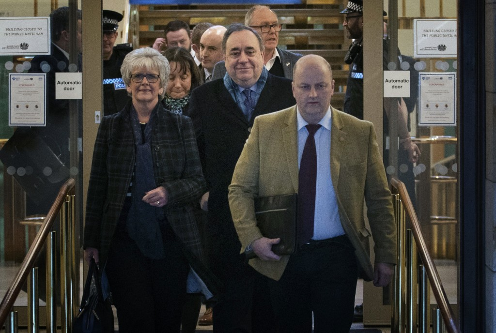 Former Scottish First Minister Alex Salmond, centre, leaves the High Court after the tenth day of his trial where he is accused of a total of 13 alleg...
