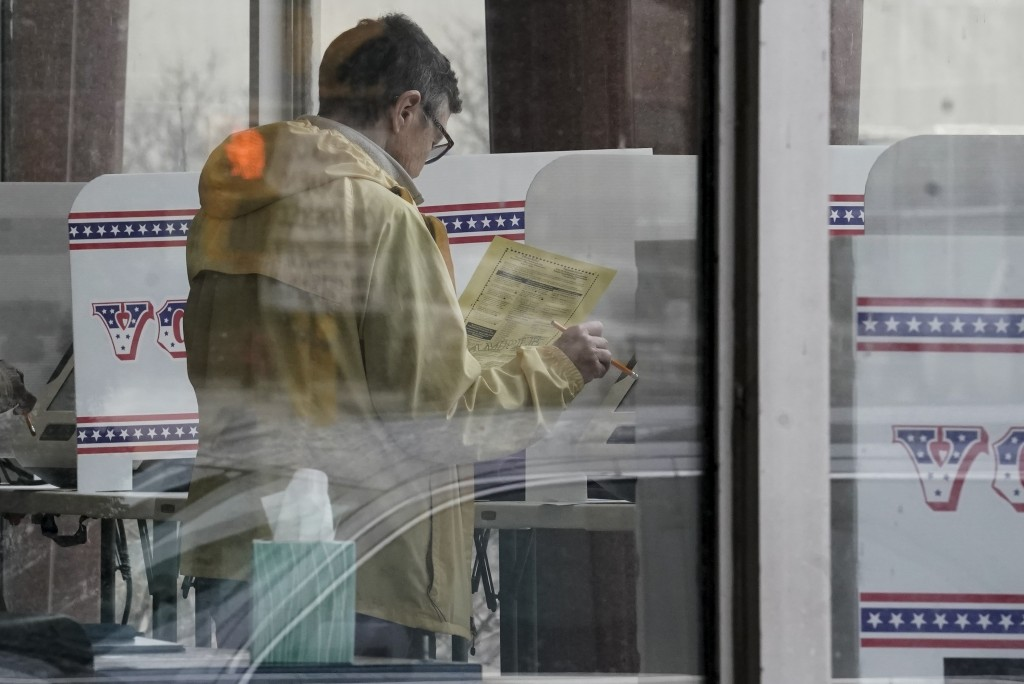 FILE - In this March 18, 2020, file photo early voters cast their ballots at the Frank P. Zeidler Municipal Building in Milwaukee, Wis. U.S. elections...