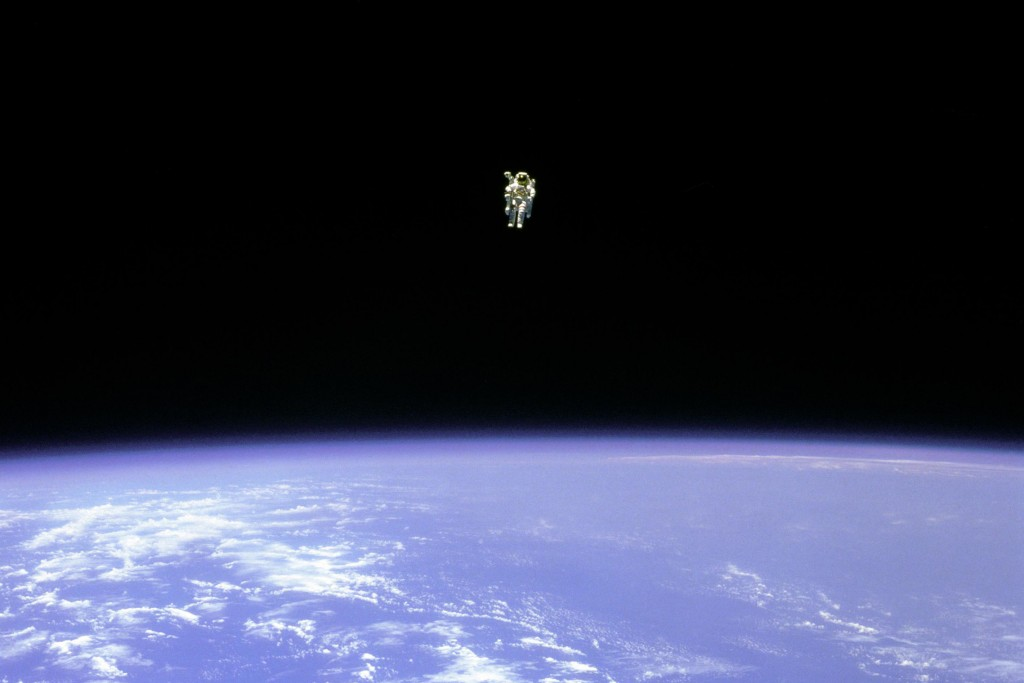 FILE - In this Feb. 12, 1984 photo made available by NASA, astronaut Bruce McCandless uses a nitrogen jet-propelled backpack, a Manned Manuevering Uni...