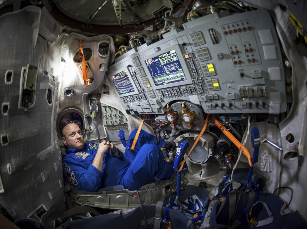 FILE - In this Wednesday, March 4, 2015 photo provided by NASA, astronaut Scott Kelly sits inside a Soyuz simulator at the Gagarin Cosmonaut Training ...