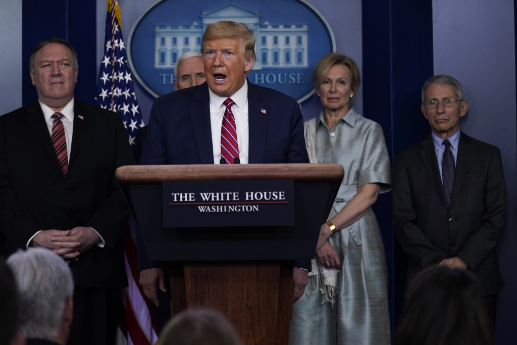 President Donald Trump speaks during a coronavirus task force briefing at the White House, Friday, March 20, 2020, in Washington. From left, Secretary...