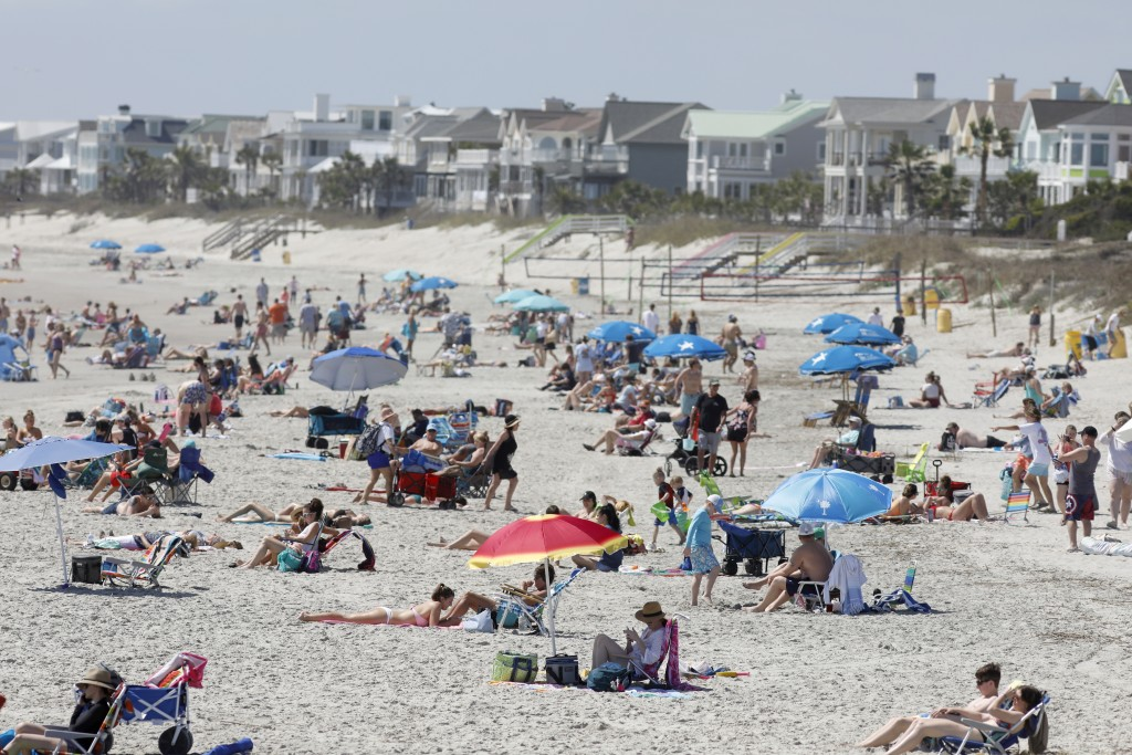 Despite warnings from government officials take caution and self distance because of coronavirus, beach goers enjoy the Isle of Palms beach, Friday, M...