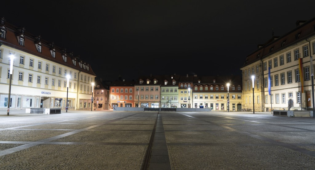 The deserted Maximiliansplatz is seen in the city center of Bamberg, Germany, shortly after midnight, early Saturday morning, March 21, 2020. A curfew...