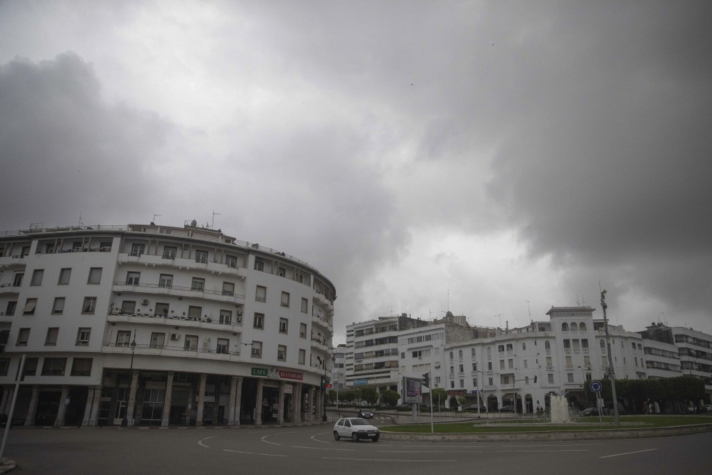 Cars drive on a main avenue on the day when Morocco declared a health emergency and further limited movement to prevent the spread of the coronavirus,...