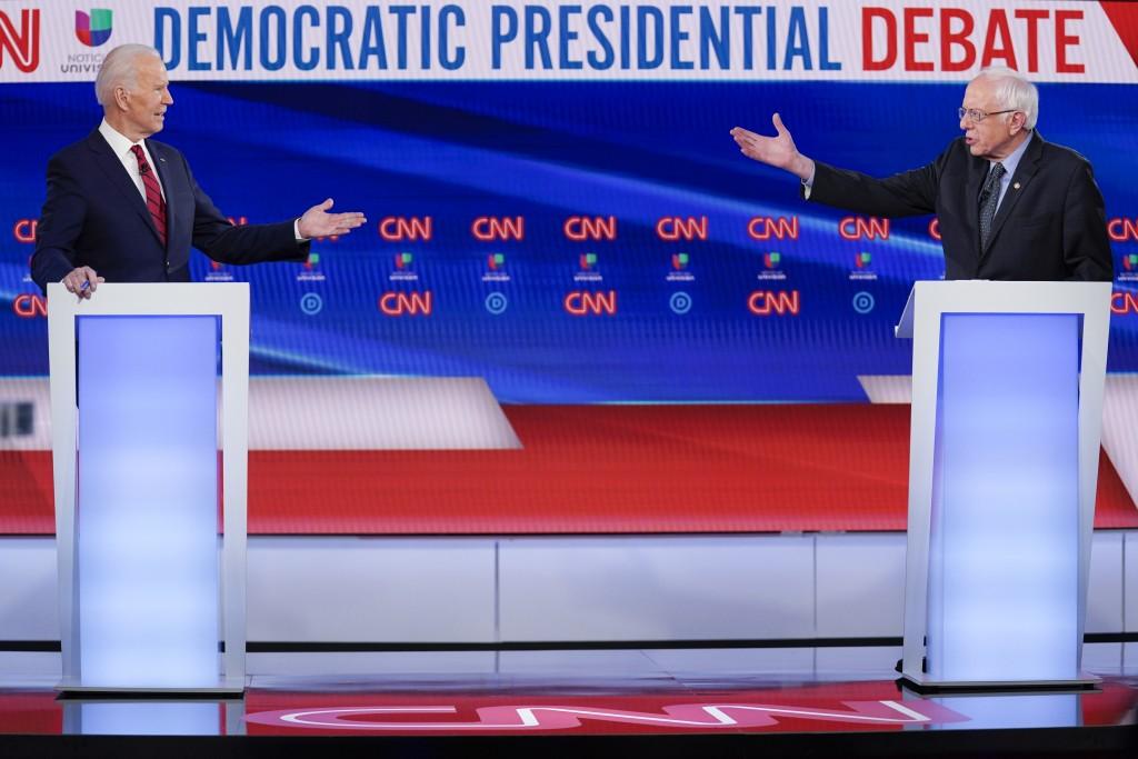 FILE - In this March 15, 2020, file photo former Vice President Joe Biden, left, and Sen. Bernie Sanders, I-Vt., right, participate in a Democratic pr...