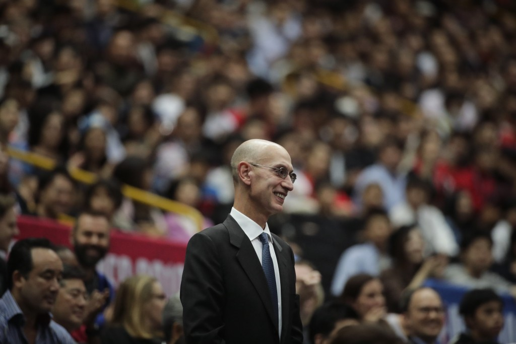 FILE - In this Oct. 8, 2019 file photo, NBA Commissioner Adam Silver is introduced during an NBA preseason basketball game between the Houston Rockets...
