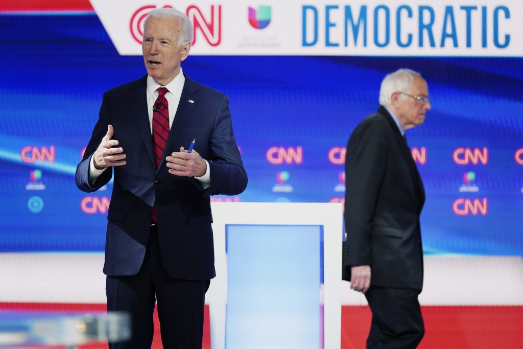 In this Sunday, March 15, 2020, photo, former Vice President Joe Biden prepares for a Democratic presidential primary debate with Sen. Bernie Sanders,...