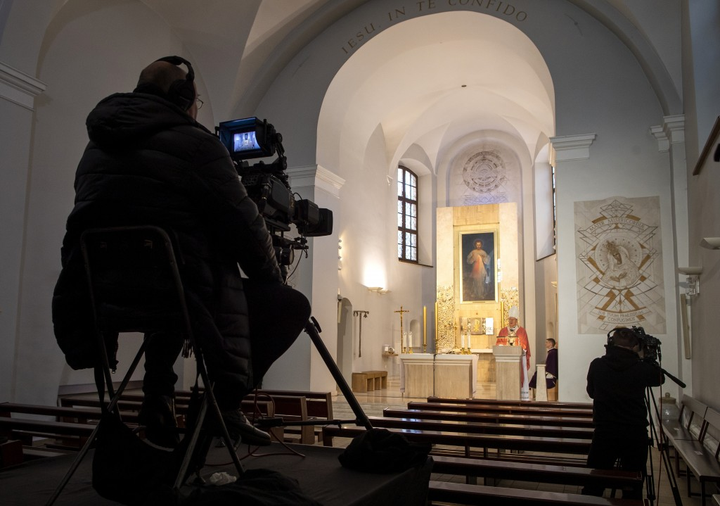 Lithuania's Archbishop Gintaras Grusas speaks during a live broadcast of the Holy Mass at an empty catholic church The Shrine of Divine Mercy in Vilni...