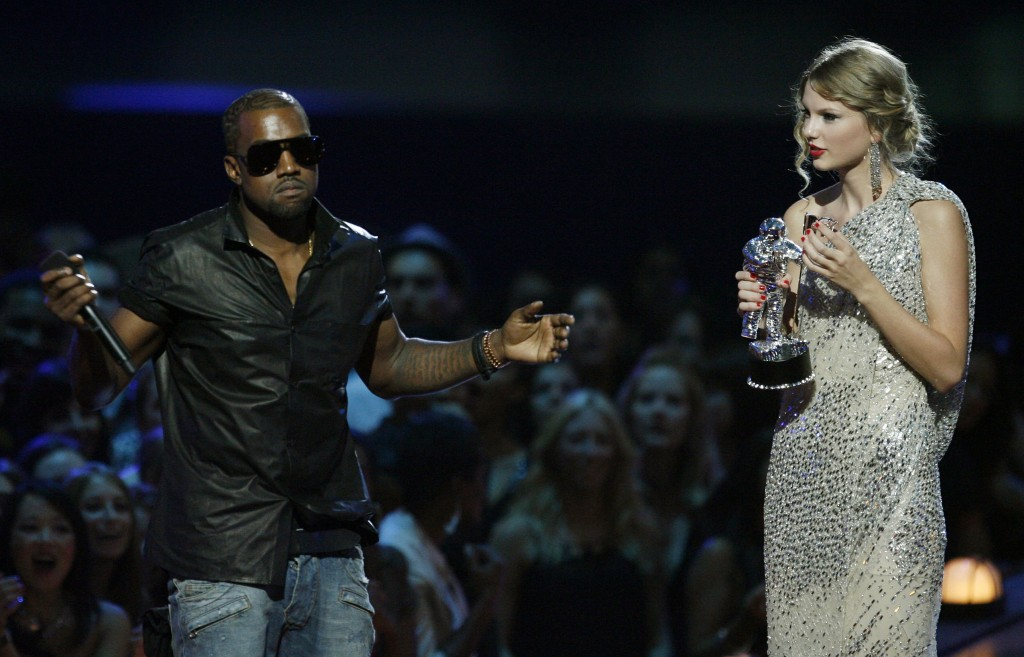 "FILE - In this Sept. 13, 2009 file photo, singer Kanye West takes the microphone from singer Taylor Swift as she accepts the ""Best Female Video"" award..."