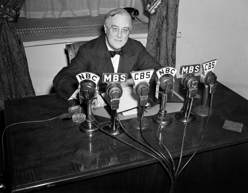 Roosevelt speaks on the radio from the Oval Room of the White House. During an extraordi