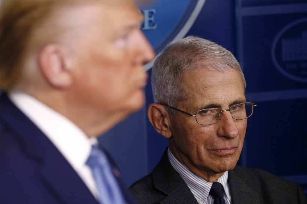 Director of the National Institute of Allergy and Infectious Diseases Dr. Anthony Fauci, right, and President Donald Trump listen as Vice President Mi...